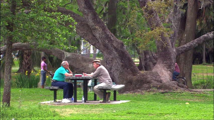 men at park bench